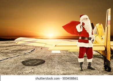 Santa claus and yellow small plane