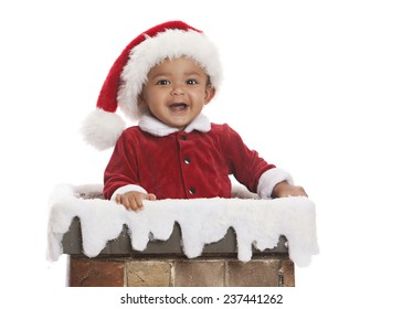 Santa Clause.  Adorable baby dressed as Santa Clause and standing in a chimney.  Isolated on white with room for your text.