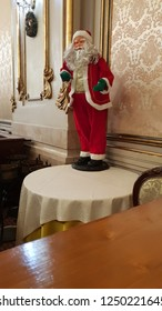 santa clause with red costume and white beard on table