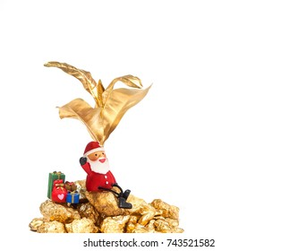 Santa Clause sitting under the golden tree with gifts waiting for Christmas, happy and prosperity concept