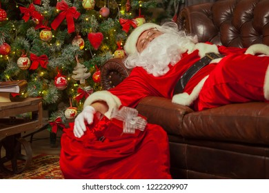 Santa Clause snoozing in a decorated living room with sack full
