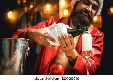 Santa congratulation you with Merry christmas and happy new year. Celebrate at home. Man in Santa Claus hat and champagne