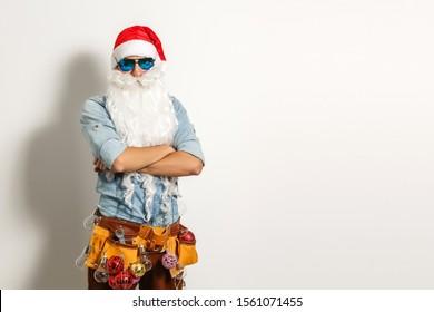 Santa with construction tools, santa repairman