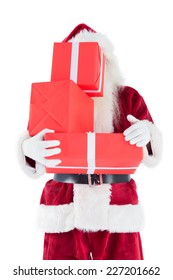 Santa covers his face with presents on white background
