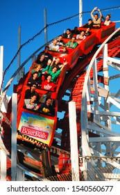 Santa Cruz, CA, USA August 12 Thrill seekers scream as they head into a descent on the Giant Dipper Roller coaster in Santa Cruz California