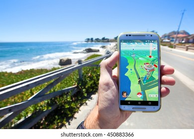 "SANTA CRUZ, CALIFORNIA - JULY 10, 2016: The hit augmented reality smartphone app ""Pokemon GO"" shows the game map based on real-world landmarks around the player's location."