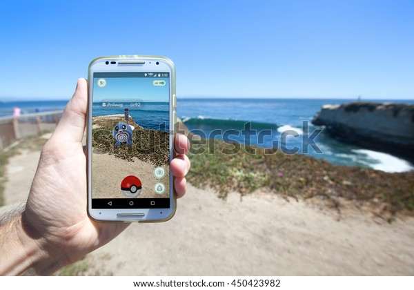 """SANTA CRUZ, CALIFORNIA - JULY 10, 2016: The hit augmented reality smartphone app """"Pokemon GO"""" shows a Pokemon encounter overlain on the real world on July 10, 2016 in Santa Cruz, California."""