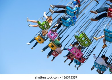 SANTA CRUZ, CALIFORNIA - JUNE 12, 2016: People enjoy a swinging ride at the Santa Cruz Beach Boardwalk on June 12, 2016 in Santa Cruz, California.