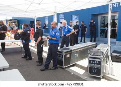 SANTA CRUZ, CALIFORNIA - MAY 31, 2016: TSA, Secret Service and Santa Cruz Police officers monitor the front entrance of the Bernie Sanders rally venue on May 31, 2016 in Santa Cruz, CA.