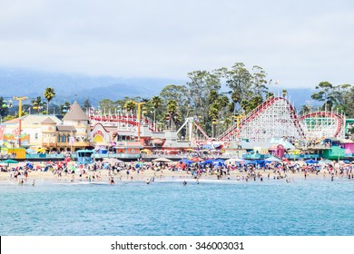 Santa Cruz, California, USA - July 5, 2015: Large crowds of people flock to the Santa Cruz Beach and Boardwalk amusement park to celebrate the Fourth of July holiday weekend.