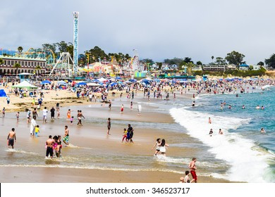 Santa Cruz, California, USA, July 5, 2015: Large crowds of people flock to the Santa Cruz Beach and Boardwalk to celebrate the Fourth of July holiday weekend.