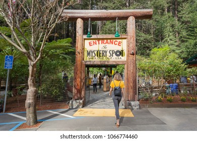 Santa Cruz, California, USA - March 31, 2018: People walk in the entrance of Mystery Spot. The Mystery Spot is a visual illusion–based tourist attraction near Santa Cruz, California,