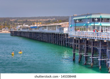 SANTA CRUZ, CA/USA - JUNE 30: The historic Santa Cruz Municipal Wharf.  Built in 1914 it extends 2,745 feet making it is the longest pier on the West Coast of the United States. June 30, 2013