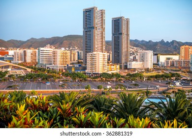 Santa Cruz cityscape view on residential buildings and offices with park and mountains on the sunrise, Canary islands, Spain