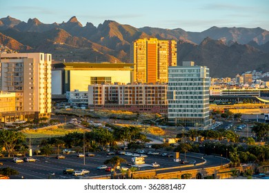 Santa Cruz cityscape view on office centers with mountains on background on the sunrise, Canary islands, Spain