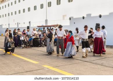 Santa Cruz de Tenerife, Canary Islands, Spain - Desember 11, 2016: Folk group meet with songs and dances of cruise ship passengers in Santa Cruz de Tenerife, Canary Islands, Spain.