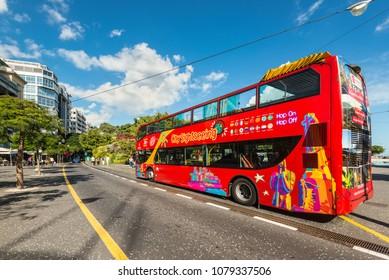 Santa Cruz de Tenerife, Canary Islands, Spain - Desember 11, 2016: City Sightseeing bus at a stop waiting for tourists in Santa Cruz de Tenerife, Canary Islands, Spain.