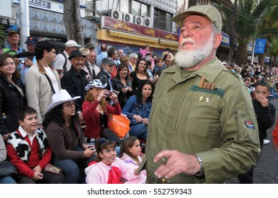 SANTA CRUZ DE TENERIFE, CANARY ISLANDS - FEBRUARY 24, 2009: Man disguised as Fidel Castro, in the parade announcer of the Carnival of the city