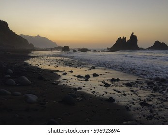 Santa Cruz de Tenerife, Canary Islands: sunset panorama at the wild Playa de Benijo beach with black sand and rocks