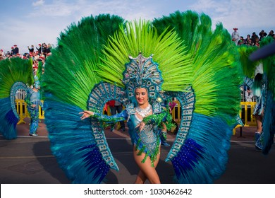 SANTA CRUZ DE TENERIFE, SPAIN – FEBRUARY 13, 2018:  Coso Apoteosis del Carnaval Santa Cruz de Tenerife -  Grand Carnival Parade. Beautiful woman dancing in bright colorful costume.
