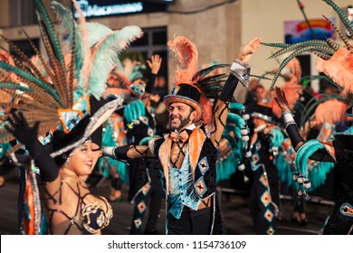 SANTA CRUZ DE TENERIFE, SPAIN- FEBRUARY 09, 2018: Women and man dancing samba music at carnival party