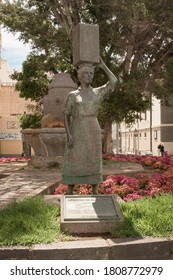 Santa Cruz de Tenerife, Tenerife / Spain - Circa July 2020: statue in the town centre representing a lady with a jar of milk on her head