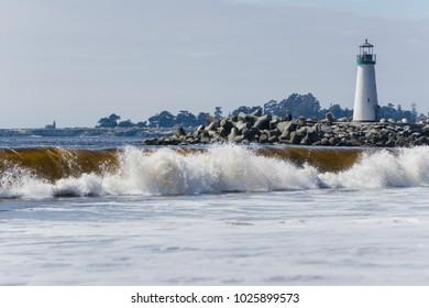 Santa Cruz harbor lighthouse on a hazy blue day in California