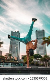 SANTA CRUZ, TENERIFE - DECEMBER 12, 2018: Boy doing one arm handstand in the city of Santa Cruz de Tenerife.