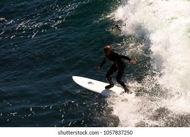 Santa Cruz, USA - May 2, 2015: Surfing in the cold Pacific ocean waters
