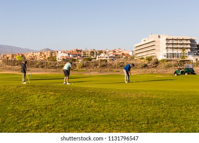 Santa Cruz,Spain,Europe-28/03/2018.Two golf players on a course near Santa Cruz on the island of Tenerife