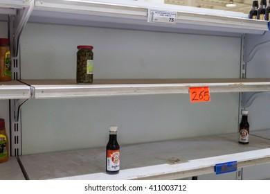 SANTA ELENA DE UAIREN, VENEZUELA - AUGUST 12, 2015: Empty shelves in a supermarket. Shortages of basic supplies are common in Venezuela.