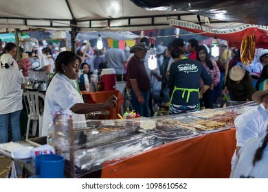 "Santa Elena, Medellin / Colombia - August 7. 2017: Women selling street food on a festival called ""Feria de las Flores""."