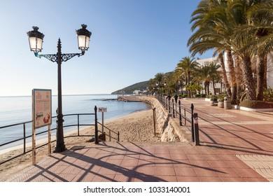 SANTA EULARIA DES RIU, SPAIN- JANUARY 12, 2018: Maritime promenade and beach in balearic town of Santa Eularia des Riu, Ibiza, Spain.