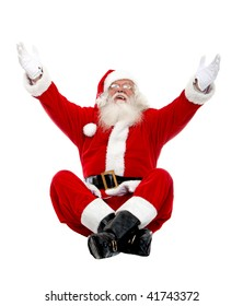 Santa excited with open arms and sitting isolated on white