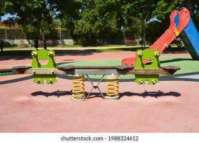 Santa Faz, Alicante, Spain - June 8, 2021: Empty Seesaw on playground in San Diego Plaza in Santa Faz.