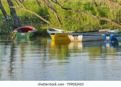 SANTA FE, ARGENTINA, JANUARY - 2017 - Small boats at shore of parana river in San Nicolas, Argentina