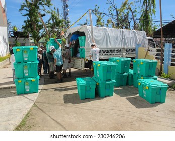 SANTA FE, CEBU, PHILIPPINES - DECEMBER 5th 2013: UK overseas aid charity workers loading ShelterBox dIsaster relief  emergency aid onto trucks after Typhoon Haiyan in the Philippines