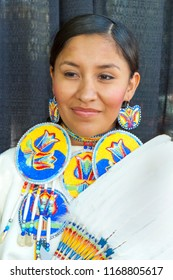 SANTA FE, NEW MEXICO, USA - AUGUST 18, 2013: Santa Fe Indian Market,  Native American young woman, traditional costune Annual event
