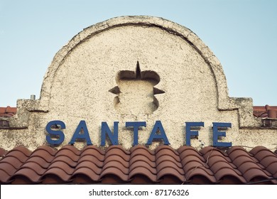 Santa Fe sign seen on the top of historic railway station building in downtown of the city.