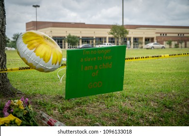 """Santa Fe, Texas May 21st 2018: Memorial sign reading """"I'm no longer a slave to fear I am a child of God"""" outside of Santa Fe High School after a student gunman shot multiple people killing 10."""