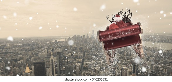 Santa flying his sleigh against new york