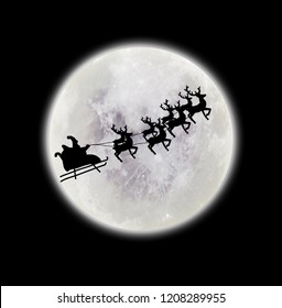 Santa flying over full moon