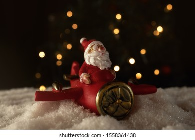 Santa flying a red plane