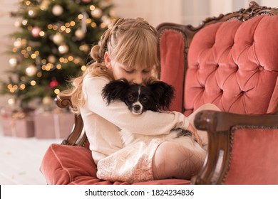 Santa gave the girl a dog for Christmas. Christmas tale. Happy childhood. First pet.