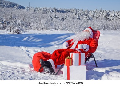 Santa with gifts in snowy forest