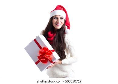 Santa girl holding gift on white background. Isolated.