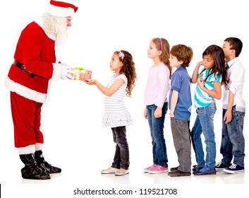 Santa giving Christmas presents to a group of kids lining up - isolated