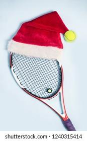 santa hat on tennis racket on white background.