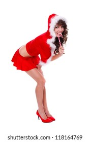 Santa helper in sexy clothes tasting lollypop
