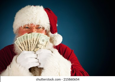 Santa: Holding Up Fanned Out Handful Of Cash